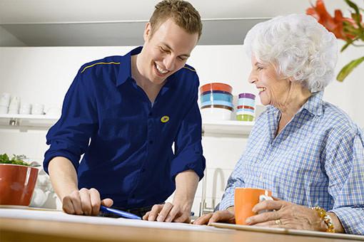 post man and elderly woman