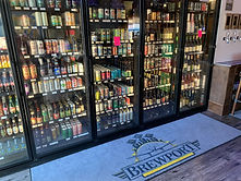 bottle shop with welcome mat for take ou