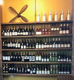 Wine bottles on shelves.jpg