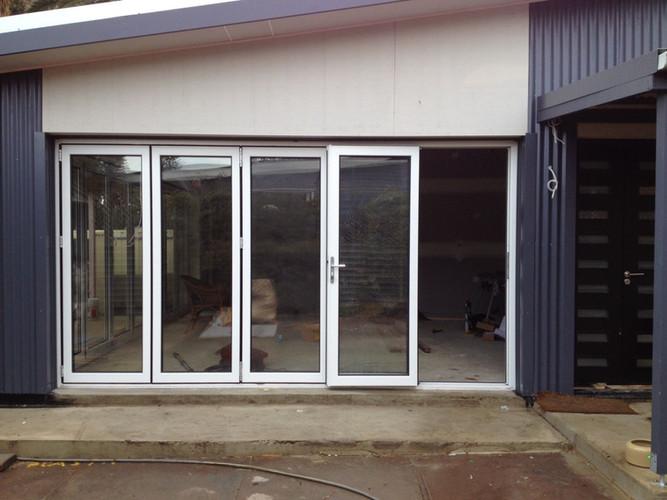All foldable glass impact doors