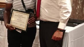 Apprentice receiving graduation certificates.