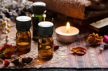 essential oils with herbs in candle ligh
