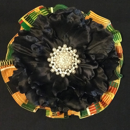 Large black Maya Angelou lapel flower with pearls center
