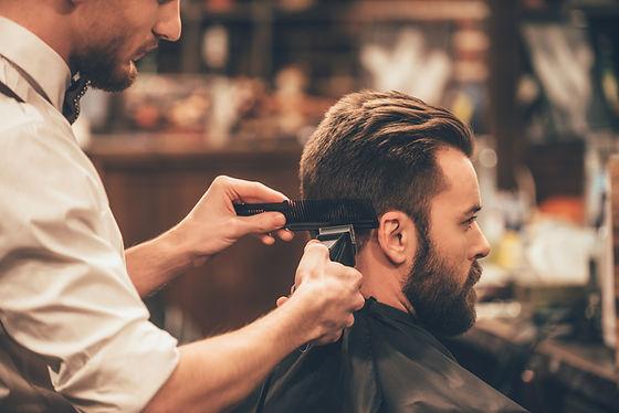 Man getting his hair cut using clippers