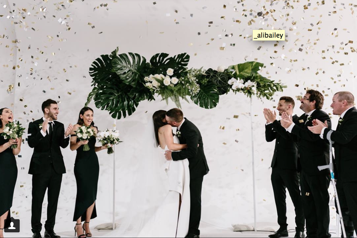 Fresh floral wedding ceremony arch