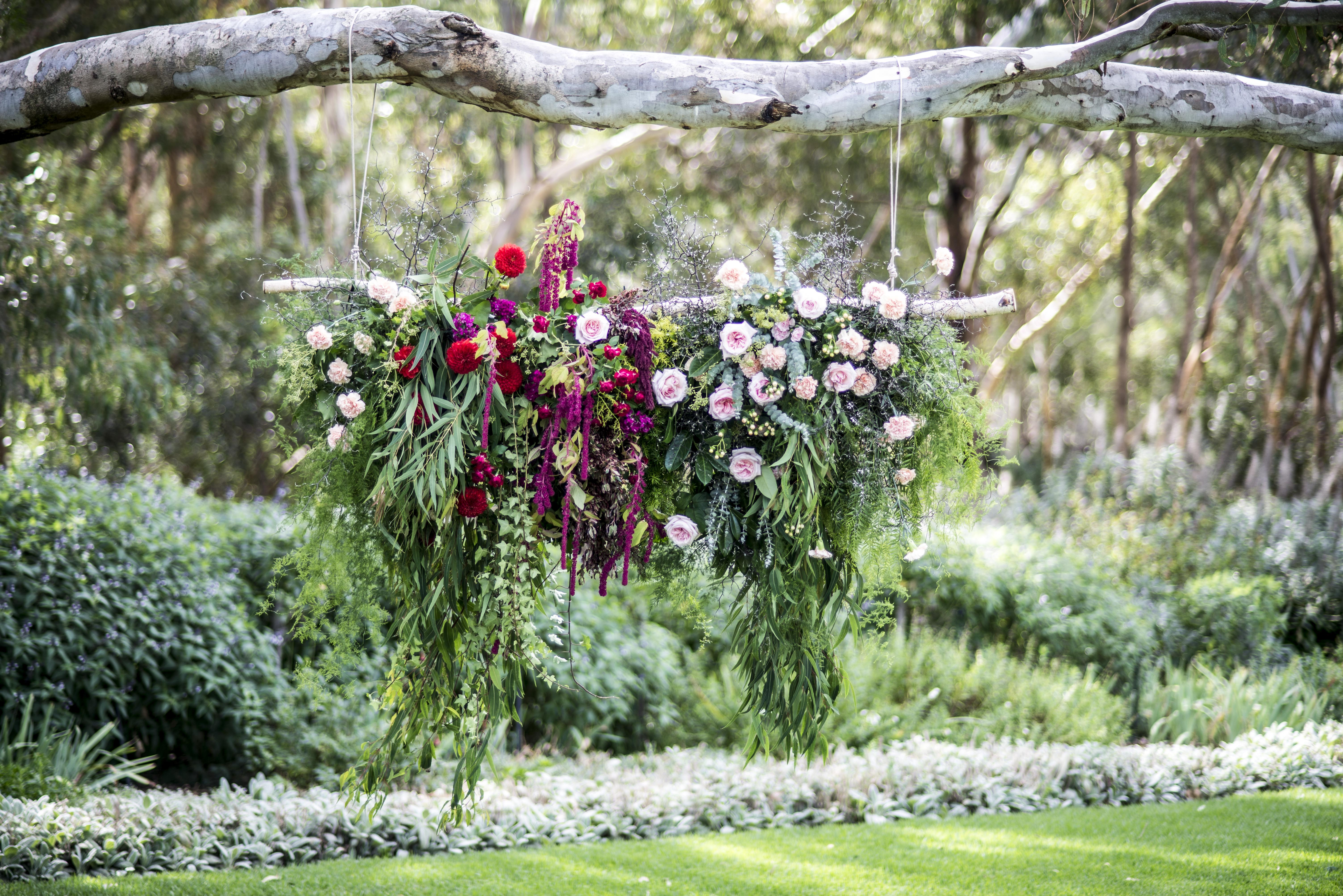 Foliage cascade ceremony backdrop