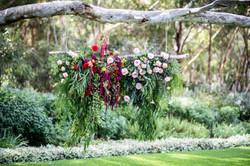 Foliage cascade ceremony backdrop