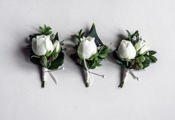 White and green buttonholes