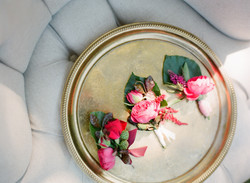 Marsala coloured floral Buttonholes