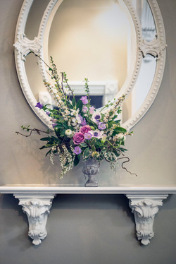 Floral arrangement in a cement urn