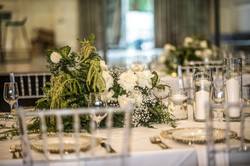 Guest table centrepieces in blush greens & cream