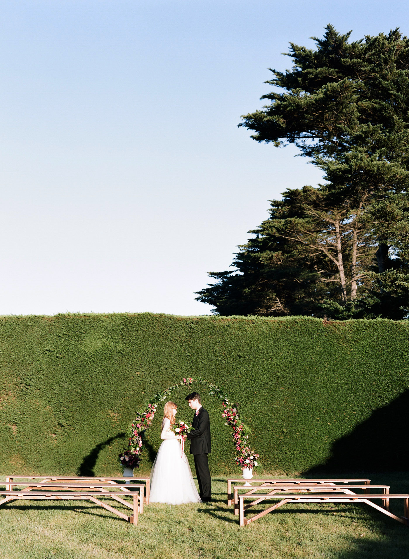 Fresh floral ceremony arch