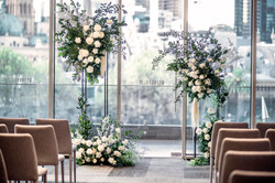 Cream & green flowers on stands