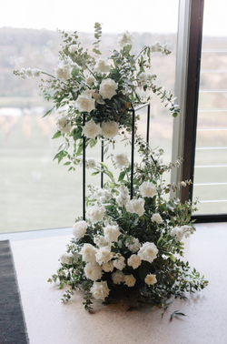 Ceremony flowers on stands