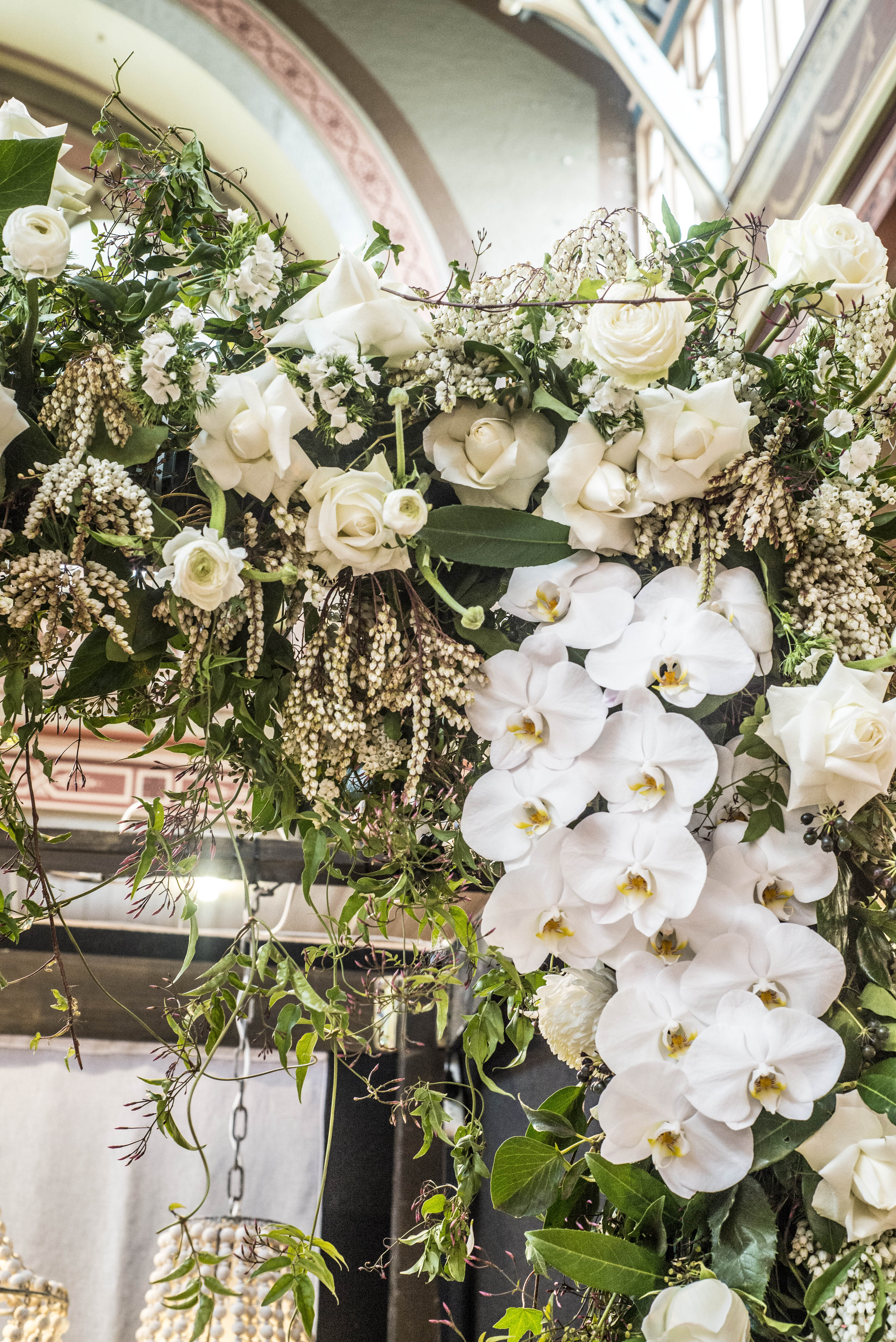 Lush white floral arch