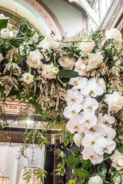 Lush white floral arch