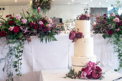 Naked cake decorated with peonies