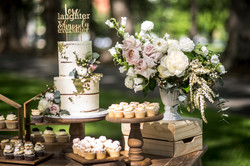 Feature urn arrangement of garden roses