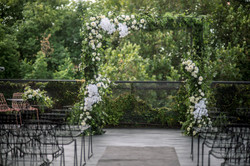 Abundant white and green floral arch