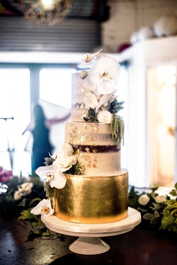 Gold & naked cake with white orchids