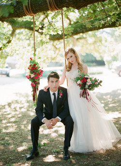 Romantic swing bound with fresh flowers