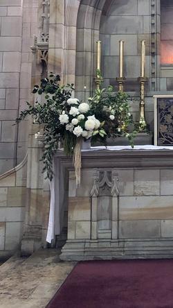 Fresh floral ceremony arrangement