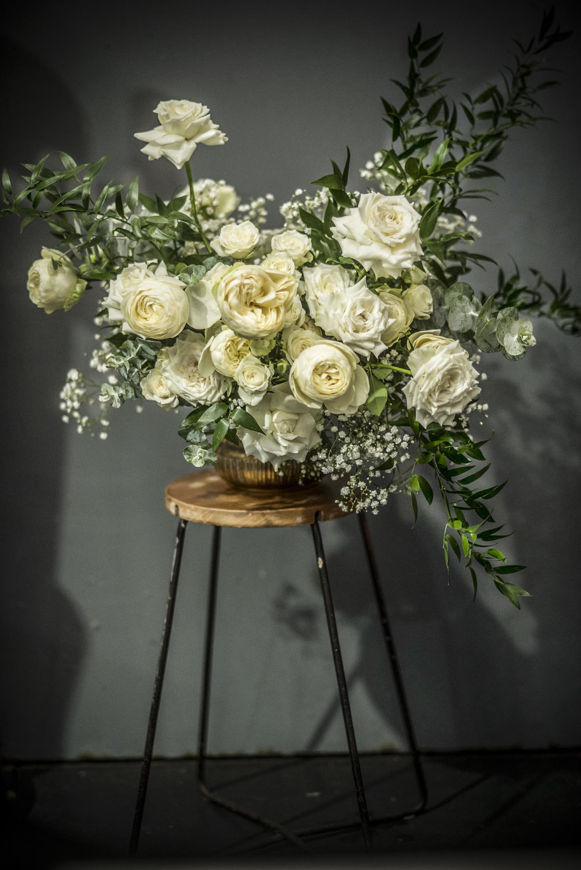 Flower arrangement in a brass urn