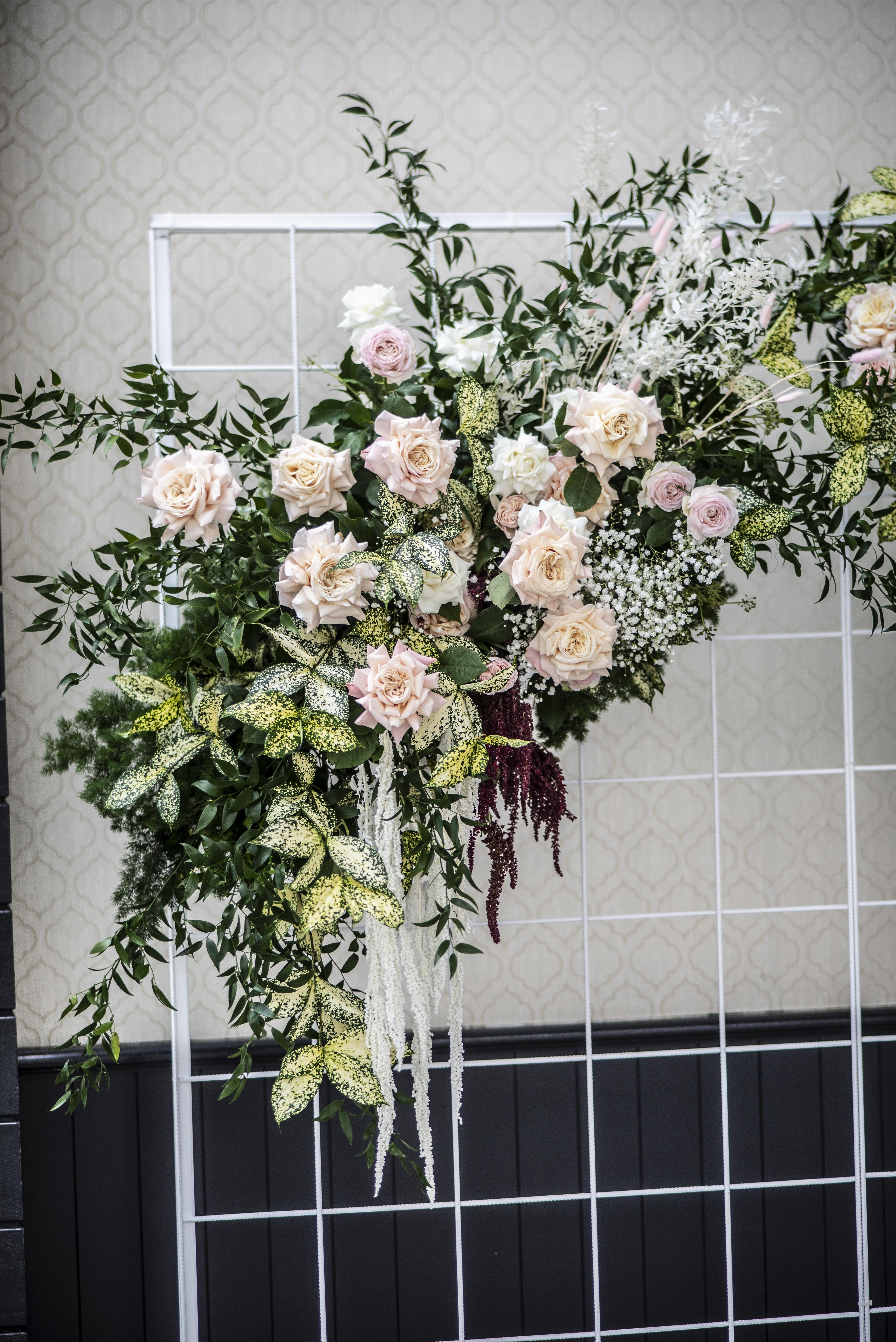 Fresh floral Photobooth backdrop over a white grid