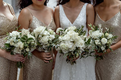 White cream & green bridal party bouquets.