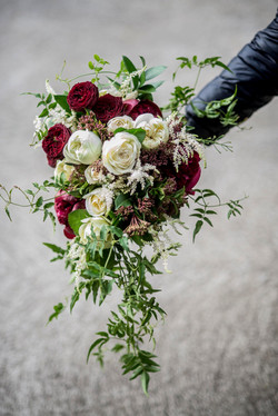 Cascading maroon & cream bouquet