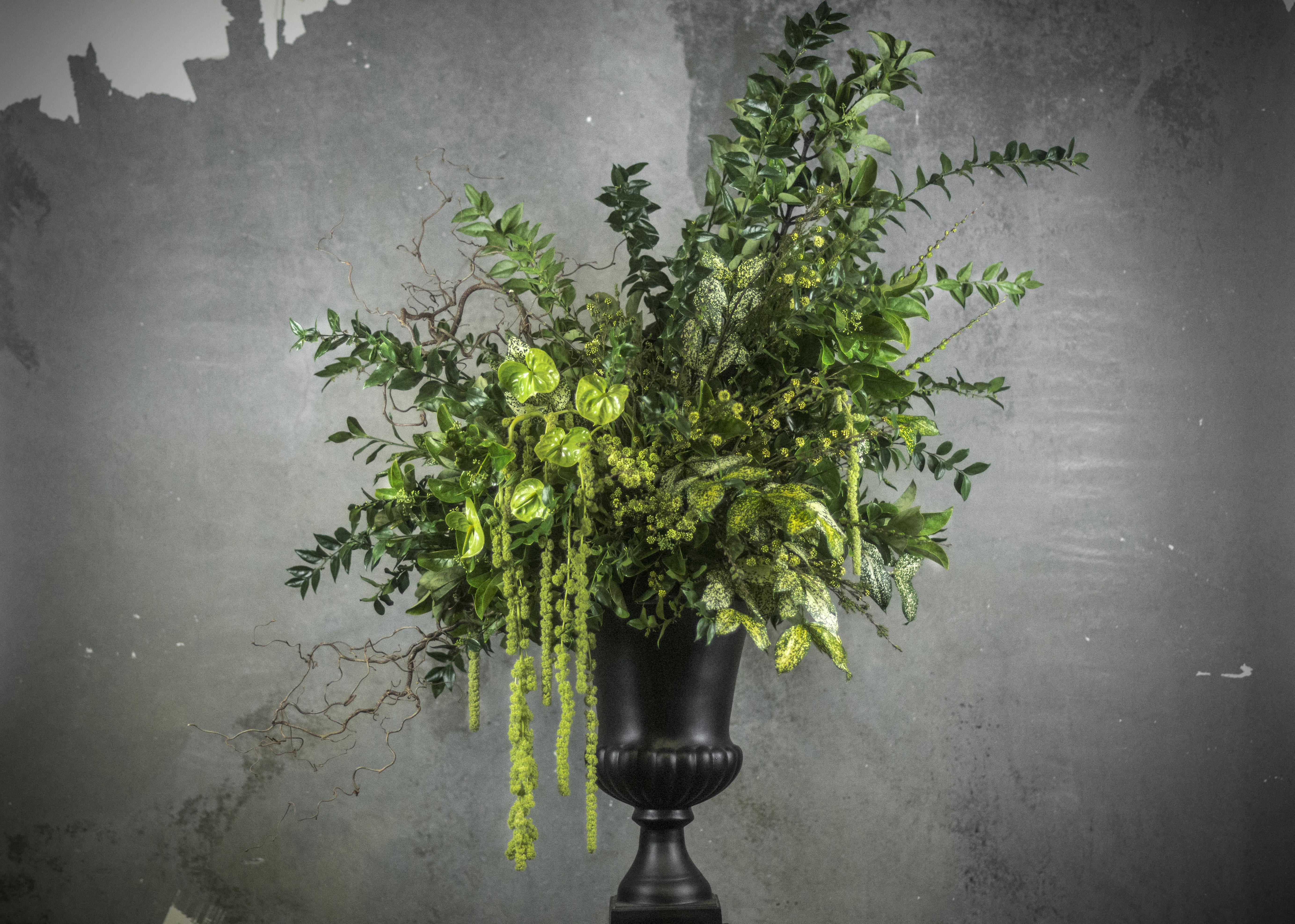 Large green urn flower arrangement