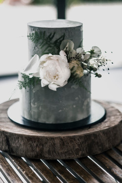 Cement look cake with peony & fern