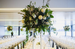 White & green flowers on table stands