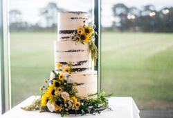 Naked cake covered with sunflowers