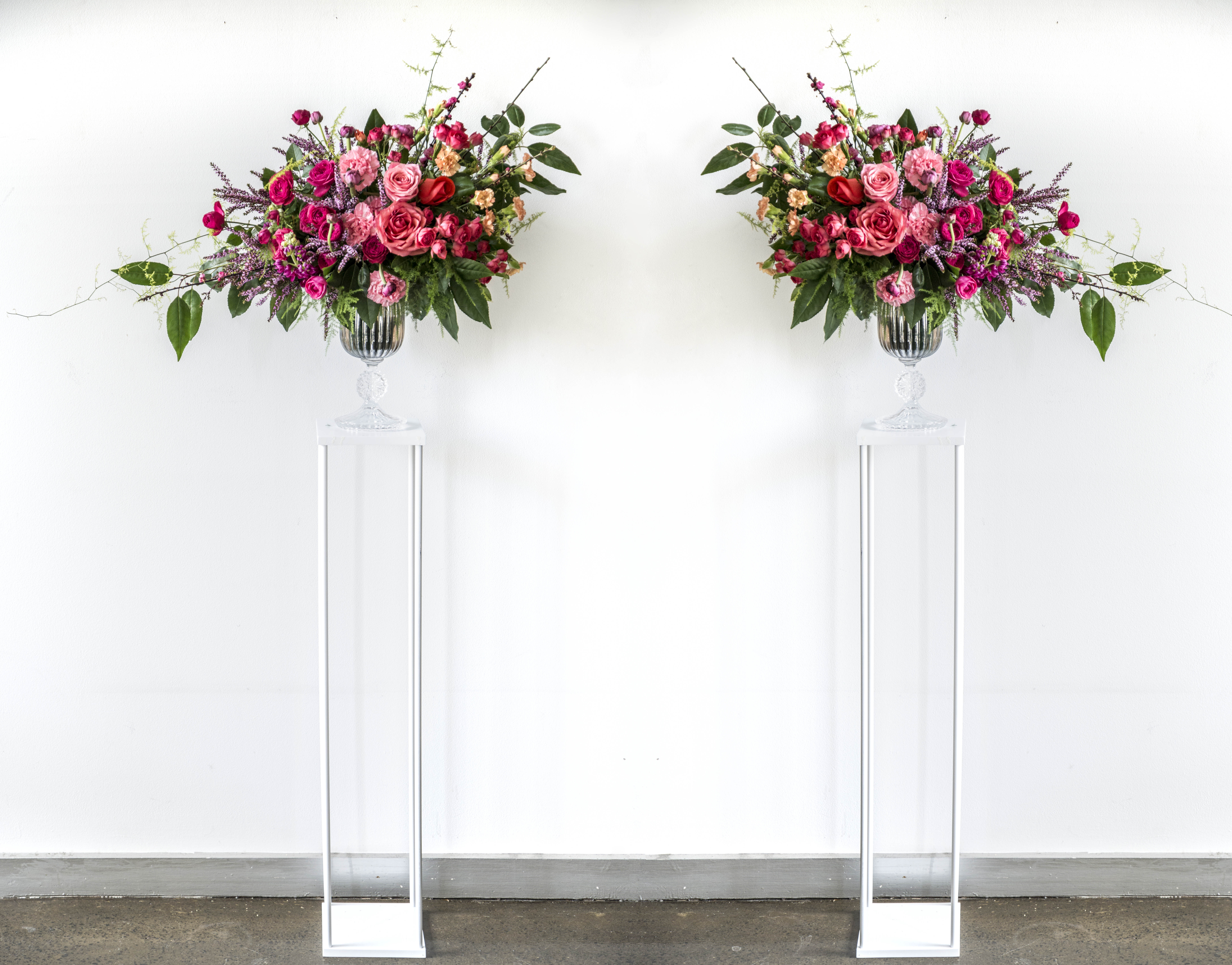 Ceremony urn arrangement on plinths