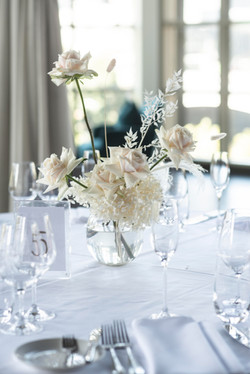 Guest table centrepieces in blush pink & cream