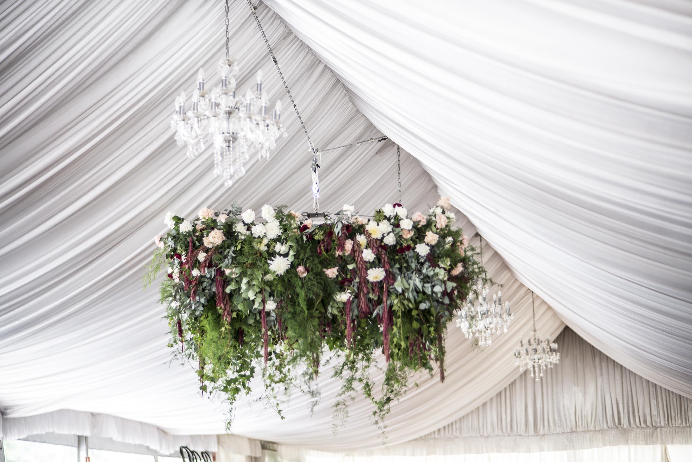 Hanging flowers in maroon & pinks