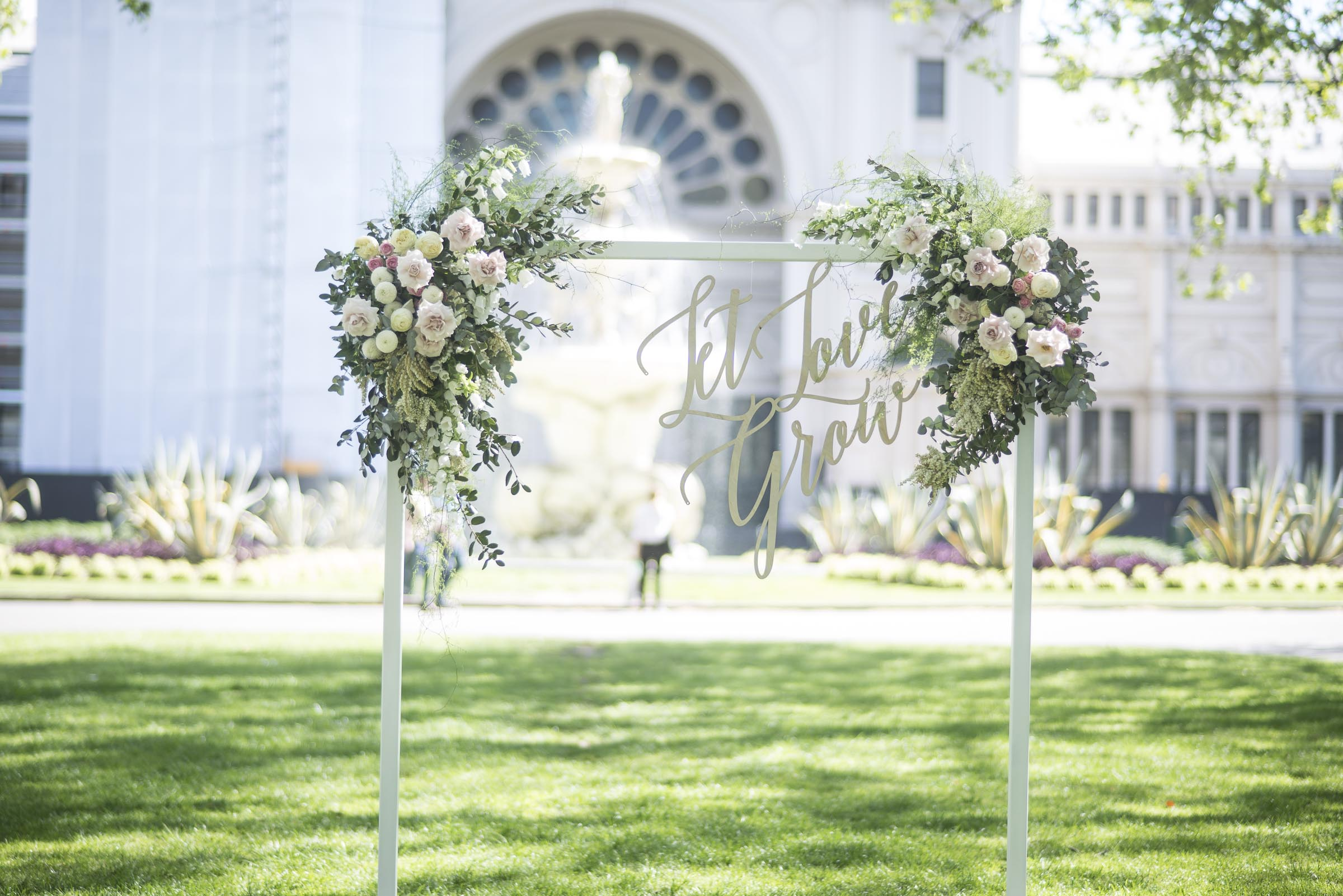 White arch ceremony backdrop