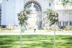 White arch ceremony backdrop