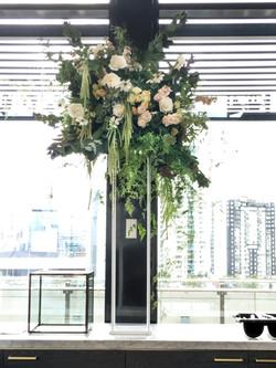 Flower arrangement on a white stand