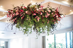 Hanging flowers in reds & pinks
