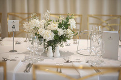White & green guest table flowers