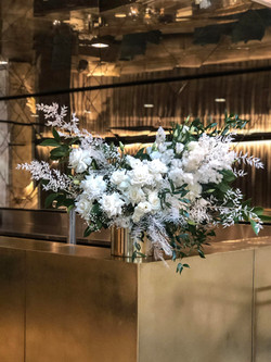Cream & green feature in a gold vase