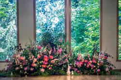 Whimsical garden ceremony backdrop