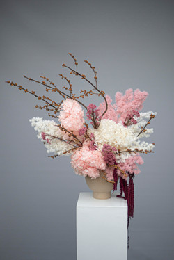 Pinks & burgundy preserved flower feature flowers