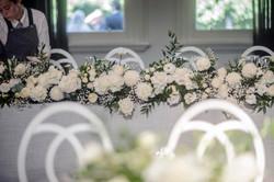 Rose filled bridal table garland