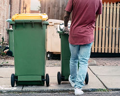 A man is sorting out the recycling bin a