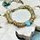 Thumbnail: Golden Rings and Turquoise bracelet