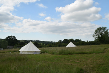 Both of our tents in the field surrounded by the beautiful views