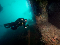 Diver entering a wreck